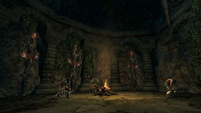 Creepy totems line the walls of another chamber in the ruins